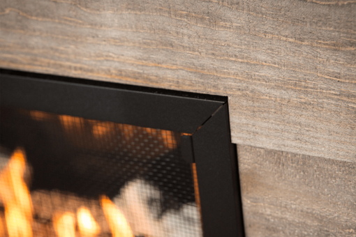 Run combustible finishing materials right up to the fireplace surround with the HeatShift system